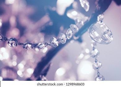 A chain of crystal rhinestones with a bokeh background of bright purple and blue