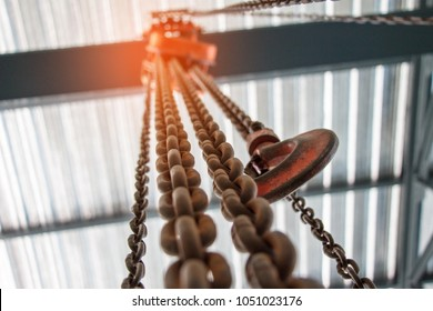 Chain Hoist. Industrial hook hanging on reel chain .