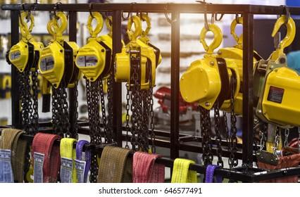 Chain hoist lift machine for factory equipment.