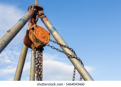 Chain hoist used in construction on blue sky background