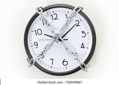 Chain holding an alarm wall clock. Business time management concept