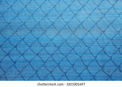 Chain Link Fence with blue tarp background. Backgrounds and Textures.