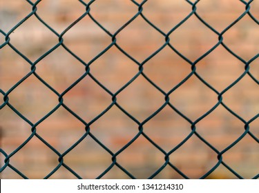 Chain Link Fence with brick Background