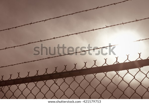 Chain Link Fence Spikes Front Blue Stock Photo (Edit Now) 421579753