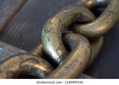 Chain Links on a Wood Table Closeup