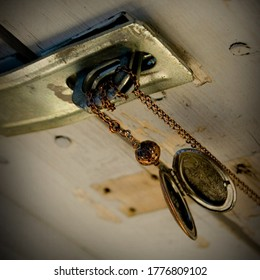 chain locket necklace on barn door