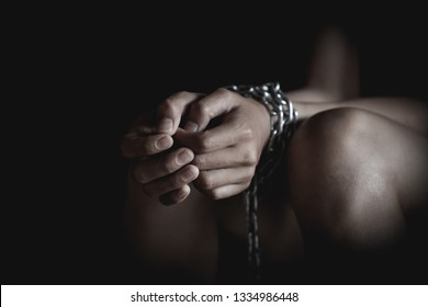 Chain on hand of female prisoners, concept of imprisonment, punishment for offenders , Human trafficking, violence against women, Slave woman, dark tone.
