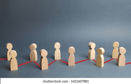 Chain of people figurines connected by red lines. Cooperation and interaction between people and employees. Dissemination of information in society, rumors. Communication and social networks.