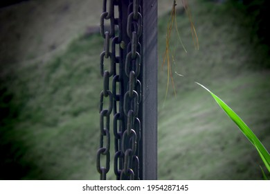 A chain and pole against a blurred background