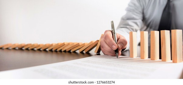 Chain Reaction In Business Concept, Businessman Intervening Chain By Signing A Contract