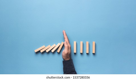 Chain Reaction In Business Concept, Businessman Letting Or Preventing  Dominoes Continuous Toppling.
