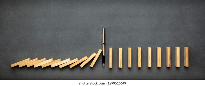 Chain Reaction In Business Concept, Pen Intervening Dominoes Toppling