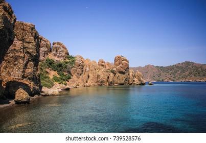 chain of rocks in the sea, a bay among rocks, a mountainous island