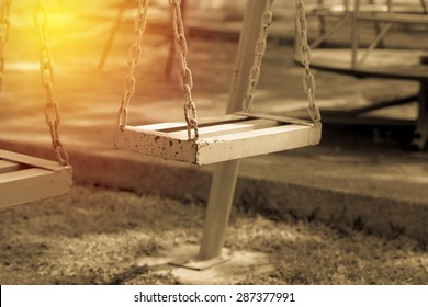 Chain swing in playground. Vintage filter.