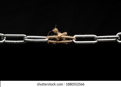 The chain is tied together with a rope. Weak link in the chain.