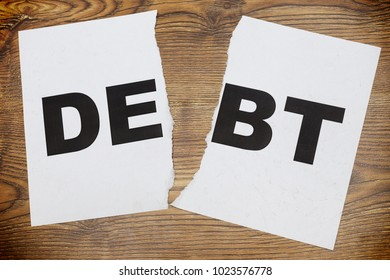 Chain with word DEBT. Concept of debt and financial entrapment