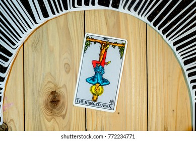 "Chainat Province, Thailand, December 9, 2017. illustrative editorial tarot cards ""THE HANGED MAN ."""