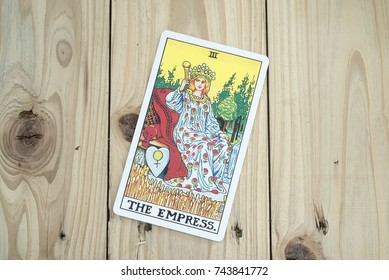Chainat Province, Thailand, October 24, 2017. illustrative editorial tarot cards .The Empress of Tarot cards on wooden background