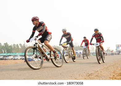 CHAINAT, THAILAND - MARCH 8 : Unidentified biker riding a mountain bike at Thailand Championship 2014 Race 3 on March 8, 2014 in Chainat, Thailand.