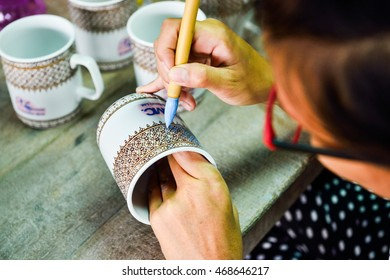 CHAINAT, THAILAND - OCTOBER 17, 2014 : Thai people working process paint Ceramic Benjarong is traditional Thai five basic colors style pottery Thailand.