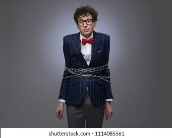 Chained funny business man trying to free himself