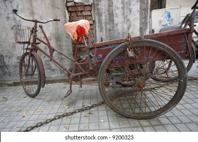 A chained and locked up tricycle cart in Tianjin, China.