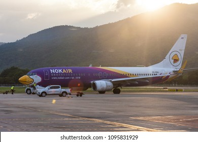 Chaing Mai Thailand 20 MAy 2018: Nok air Boeing 737-800 HS-DBA was pushed back from jet bridge in Chaing Mai international airport in evening and sunset