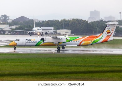 Chaing Mai Thailand 23 Sep 2017 : Nok air with Bombadier Q400 Nextgen was landing on Chiang Mai international airport while the weather was raining