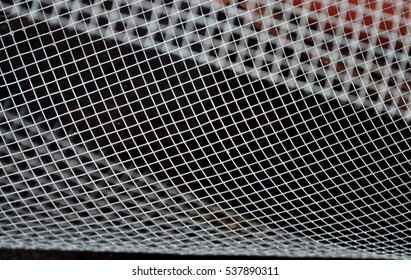 chain-link fence with abstract shapes
