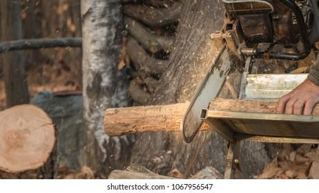 Chainsaw chopping wood