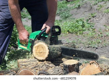 Chainsaw in male hands