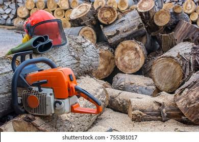 Chainsaw split tree trunk with safety helmet