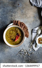 Chainsoo is a traditional pahadi dal recipe of Uttarakhand style made using ground black lentil and black eyed beans with a strong taste of garlic served with Ragi roti or flat Bread.  - image