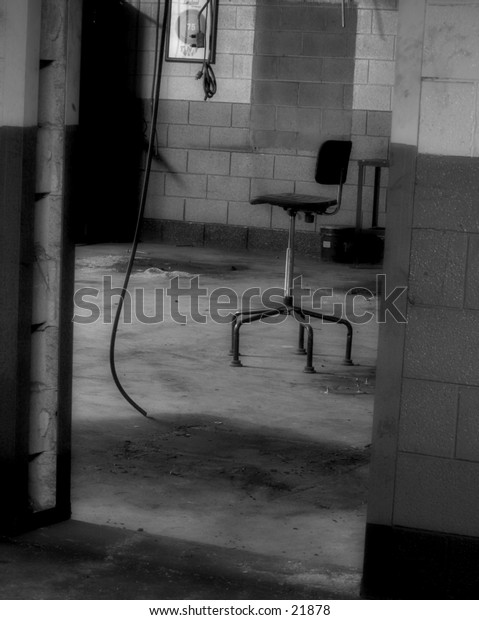 Chair in an abandoned factory. B/W.