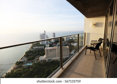 chair at balcony with sea view from skyscraper building - pattaya, Thailand