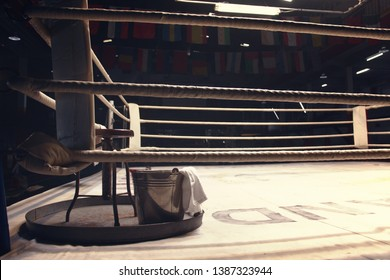 chair, bucket, towel and tray put on a corner of boxing ring