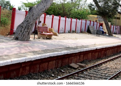 A chair is built to sit at the railway station.