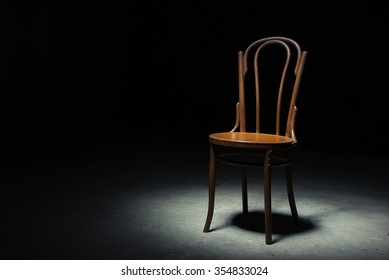 chair in the darkness