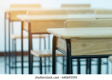 Chair in empty classroom, lecture armchairs in school, or college