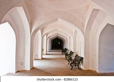 chair in Empty corridor with handcarved pillars in an abandoned Amber Fort. Rajasthan, India