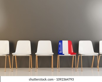 Chair with flag of france in a row of white chairs. 3D illustration