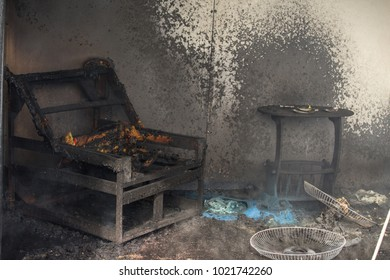 Chair and furniture in house after being burned with smoke and dust in burn scene of arson investigation course