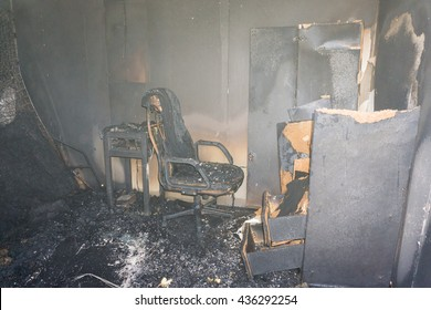 chair and furniture in room after burned by fire with smoke and dust in burn scene