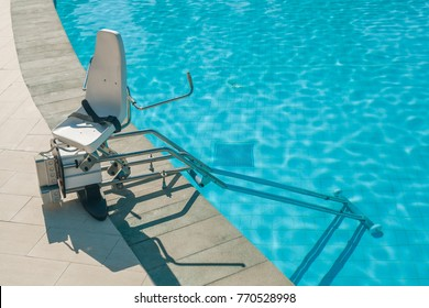 chair lift device for disabled people in outdoor swimming pool