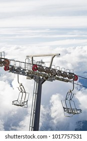 Chair lift in front of threatening cloud mountains just below the summit of Monte Bondone