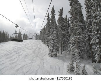 Chair lift on the ski slopes in Vail, Colorado