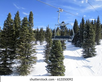 Chair lift over evergreen trees at Purgatory ski resort in Colorado