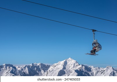 Chair Lift used by Skier in Winter
