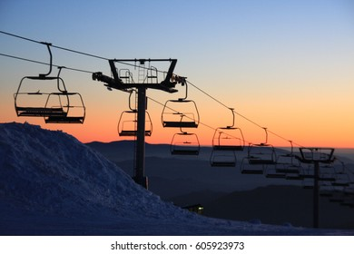 Chair lifts at sunset ski