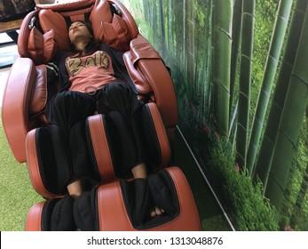 Fantastic 1000 Young Woman Sitting On A Reclining Chair Stock Creativecarmelina Interior Chair Design Creativecarmelinacom
